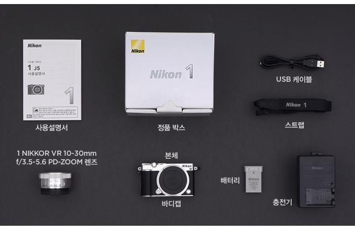 정품 박스, 1 NIKKOR VR 10-30mm f/3.5-5.6 PD-ZOOM 렌즈, 본체, 바디캡, 배터리, 사용설명서, USB 케이블, 스트랩, 충전기